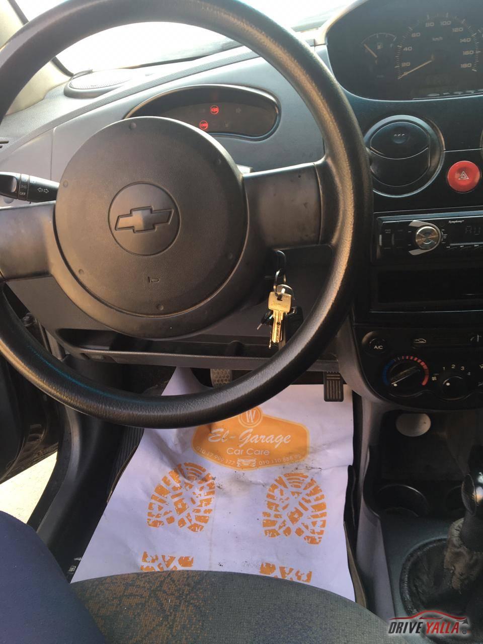 سيارة شيفورلية 2009  سبارك فبريكه بره و جوه عداد 60 الف فقط جنوط اسبور ياباني