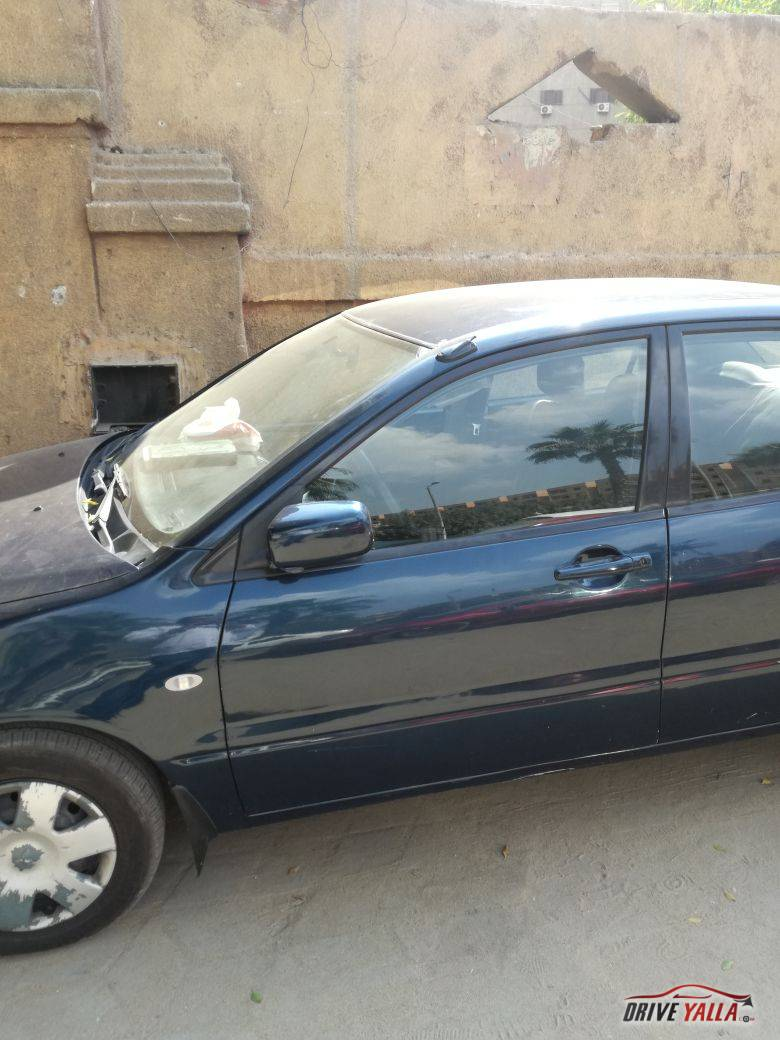 للبيع سيارة ميتسوبيشي لانسر بومة موديل 2005